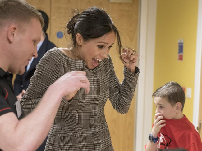 Meghan Markle watched a game of Jenga during her visit to Star Hub in Wales. Picture: Getty Images