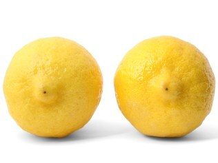 Two Lemons with grounding shadow on pure white background. Focus on nipples.