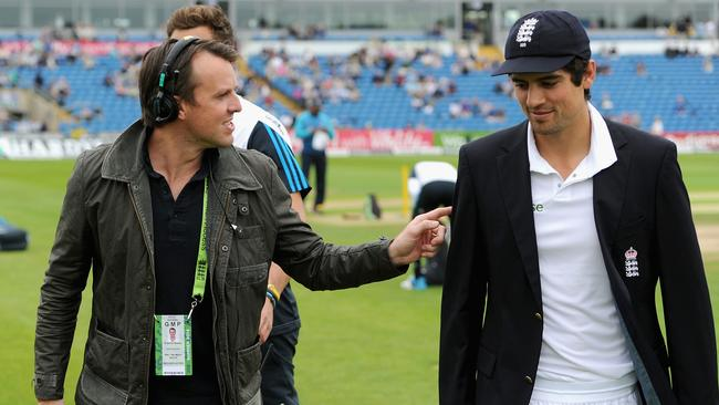 Graeme Swann (L) has taken to his media role like a duck to water - but Alastair Cook isn't too happy about it.