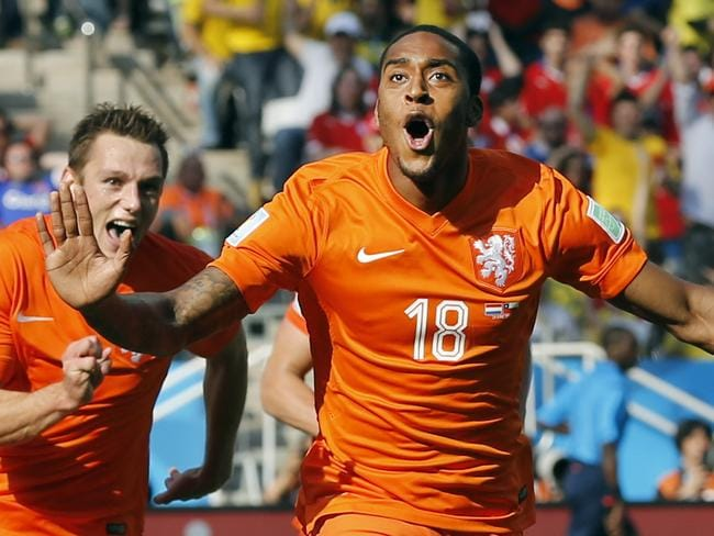 Netherlands' Leroy Fer celebrates scoring the opening goal during the group B World Cup match against Chile at the Itaquerao Stadium in Sao Paulo, Brazil.