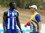 Coach Brad Scott passes on instrutions to Majak Daw at Arden St. Picture: Mark Stewart