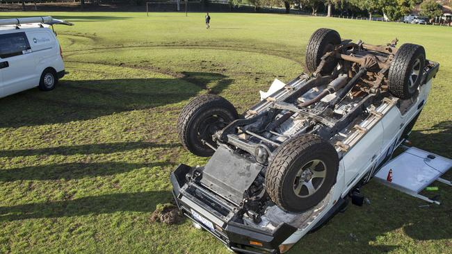 Hoons still on our roads ... A Toyota 4WD crashes onto a reserve after performing doughnuts. Picture: News Corp Australia.
