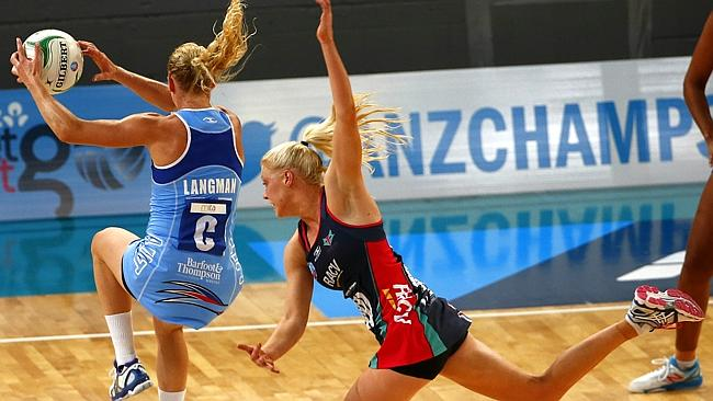 Kate Maloney does her best to incept a pass to the Mystics' Laura Langman. Picture: Michael Klein