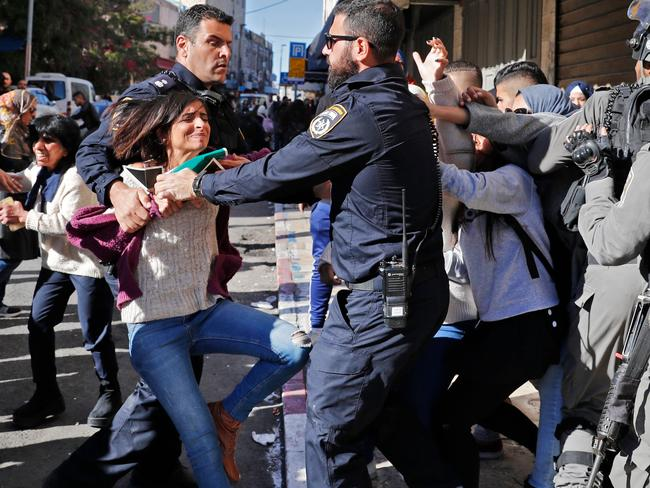 Israeli police disperse Palestinian protesters in East Jerusalem.