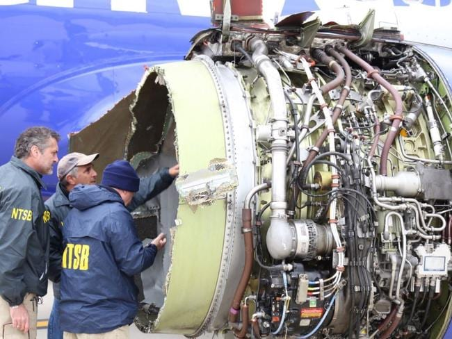 NTSB inspectors examine the engine damage. Picture: Twitter