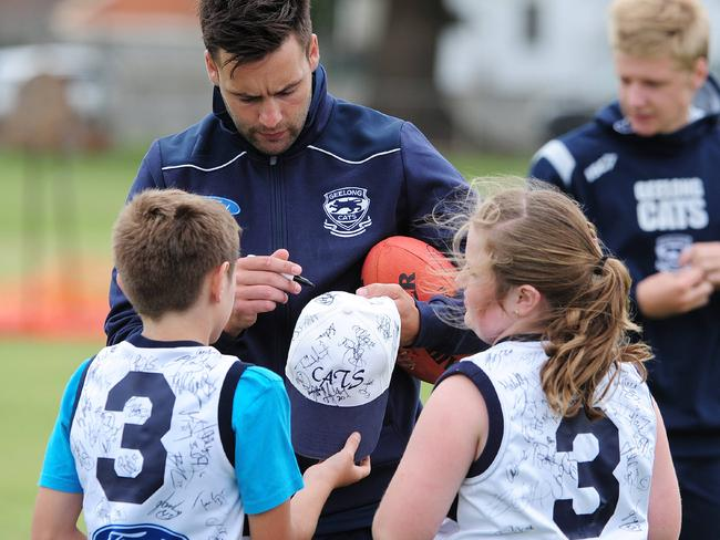 Jimmy Bartel meets some young fans who favour the hexagonal iron-on No.3.