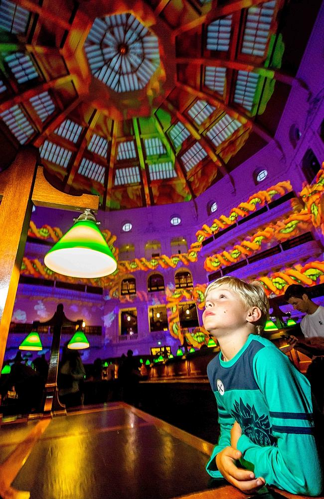 Seven-year-old Angus Russell from North Fitzroy takes in the 'Molecular Kaleidoscope' at