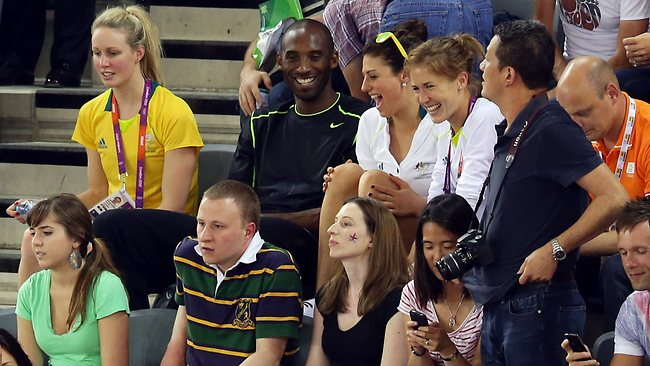 NBA star Kobe Bryant and Stephanie Rice take time out to watch the cycling at the velodrome in London. Picture: Adam Head