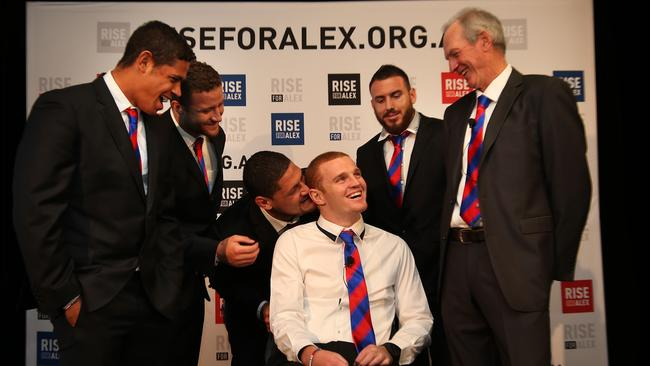 What's Willie saying? Willie Mason and Alex McKinnon share a laugh with his Newcastle teammates ahead of the Rise for Alex round. From left, Dane Gagai, Korbin Sims, Darius Boyd and Wayne Bennett. Pic. Phil Hillyard.