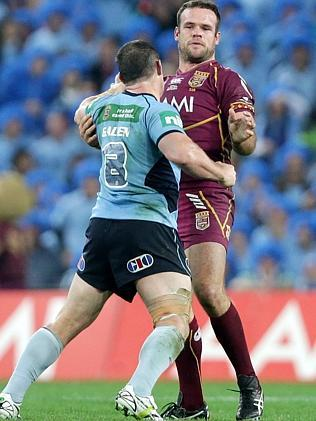 Nate Myles looks on curiously as Paul Gallen lines him up.