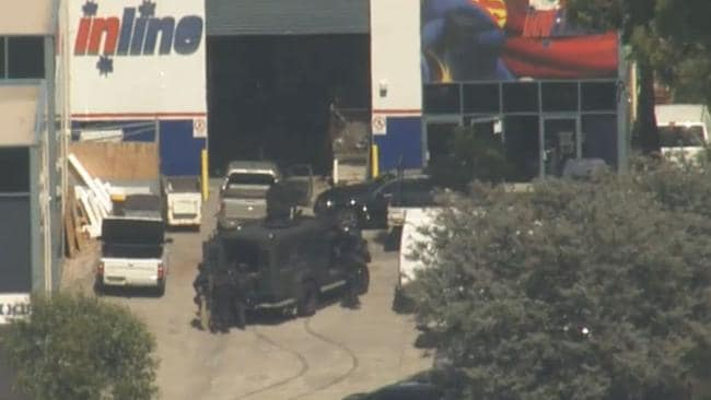 The BearCat and heavily-armed tactical police have joined the police operation surrounding the building where the gunman is holed-up. Picture: Channel 9 News