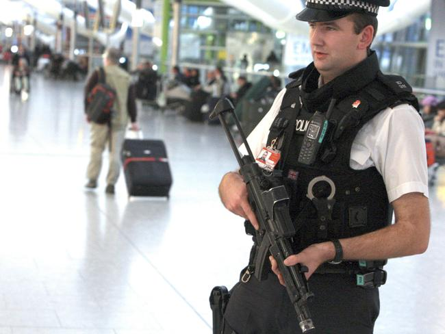 An armed police officer on patrol at Heathrow Airport's Terminal 5 (file image). Picture: AP