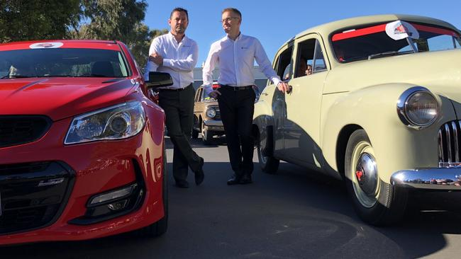 Holden managing director Mark Bernhard (left) with the head of Holden manufacturing Richard Phillips (right) at the Holden Dream Cruise in the lead-up to the factory shutdown. Photo: Joshua Dowling.