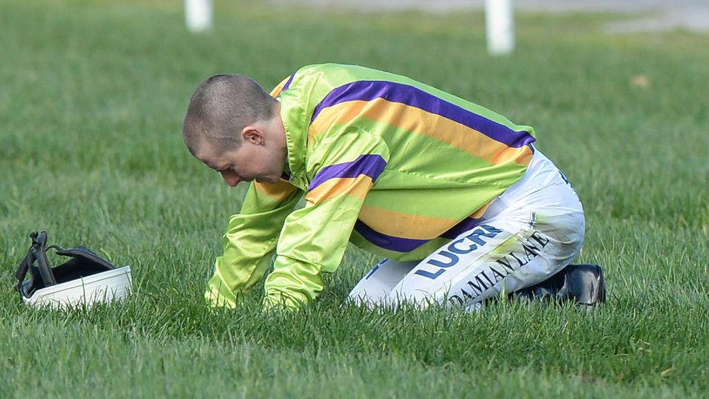 Jockey Damian Lane after falling with his horse Limestone in race 5, the Danehill Stakes, on Maybe Diva Stakes Day at Flemington Racecourse in Melbourne, Saturday, September 16, 2017. (AAP Image/Mal Fairclough) NO ARCHIVING, EDITORIAL USE ONLY