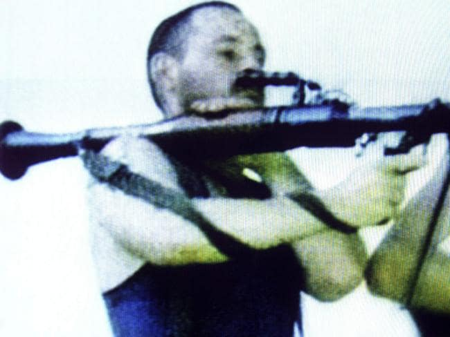 Fighter ... David Hicks holding a RPG-7 rocket propelled grenade launcher while fighting for the Kosovo Liberation Army in 1999. Picture: Channel Seven/AFP