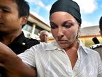2006 - Schapelle Corby is escorted by police to a court in Denpasar in Bali. Picture: Supplied
