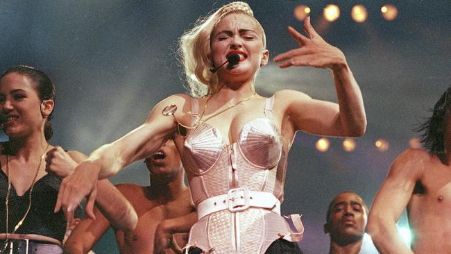 "FILE - In this June 4, 1990 file photo, pop singer Madonna performs with her dancers during her Blond Ambition tour in Worcester, Mass. ""Strike a pose,"" a new documentary that follows the dancers that accompanied Madonna on her 1990 ""Blond Ambition"" tour, will debut on the Logo channel on Thursday, April 6, 2017. (AP Photo/Sandy Hill, File)"
