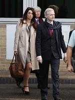 Just a few weeks later, in October 2013, Clooney was first photographed with lawyer Amal Alamuddin, left, (seen walking alongside WikiLeaks founder Julian Assange as they leave Belmarsh Magistrates Court in south east London). Picture: AP