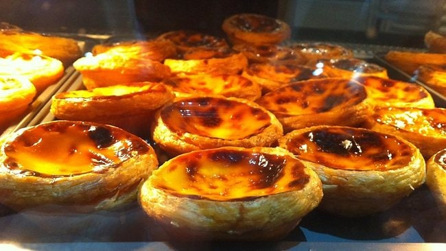 Sweet egg tarts in Hong Kong can be found all around the busy streets of the city. Picture: Marco Ooi/Flickr.