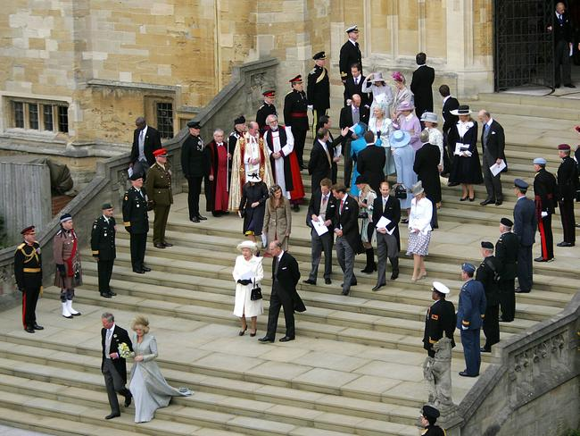 Prince Charles and the Duchess of Cornwall, Camilla, walk from St George's Chapel at Windsor Castle followed by Queen Elizabeth, Prince Philip and members of the Royal family, after their blessing and civil wedding in 2005. Picture: (Odd Andersen via AP
