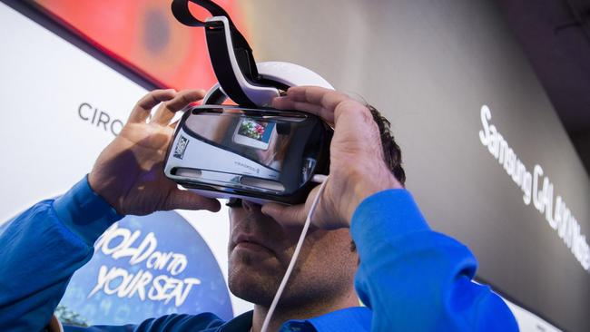 Virtual reality bites ... Checking out the Samsung Gear VR at the IFA trade show in Berlin this week. Picture: AFP