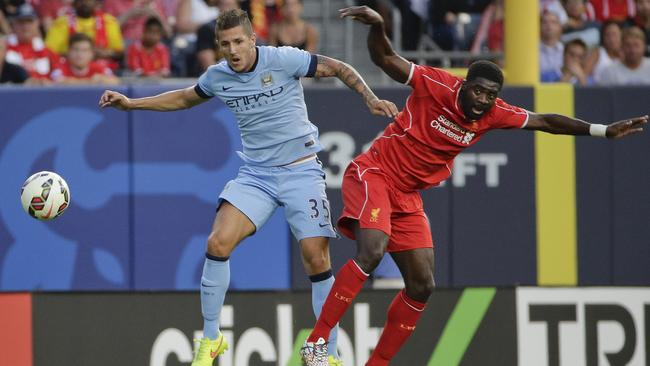 Manchester City forward Stevan Jovetic (35) challenges for the ball.