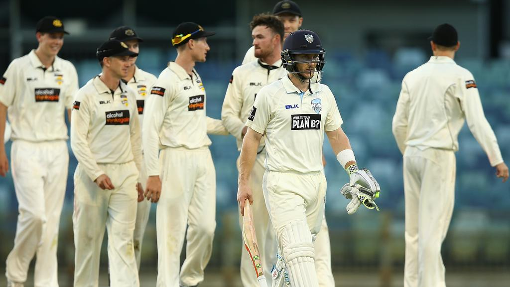 Peter Nevill walks off after falling just short of dragging NSW to victory.