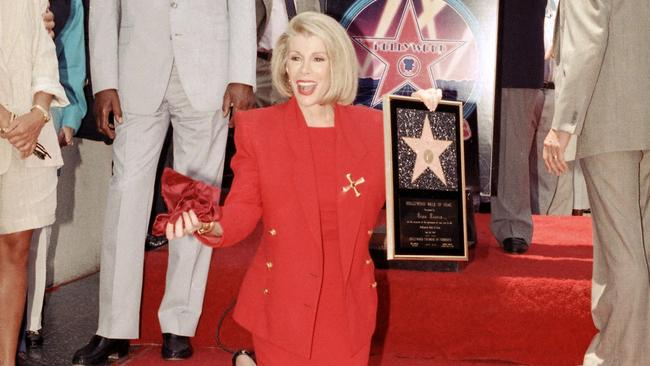Joan Rivers poses next to her star on the Hollywood Walk of Fame in 1989.
