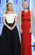 Presenters Amy Schumer and Jennifer Lawrence speak onstage during the 73rd Annual Golden Globe Awards at The Beverly Hilton Hotel on January 10, 2016 in Beverly Hills, California. (Photo by Paul Drinkwater/NBCUniversal via Getty Images)