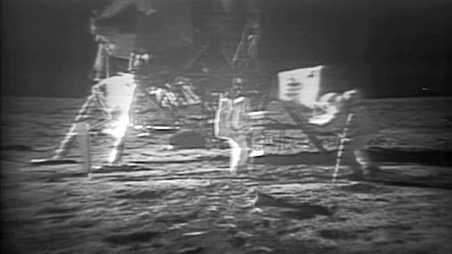 NASA's newly unveiled restored video footage of man's first steps on the moon to mark the 40th anniversary of the Apollo 11 mission's historic stride into space in 1969. With one small step off a ladder, astronaut Neil Armstrong, became the first human to set foot on the moon.