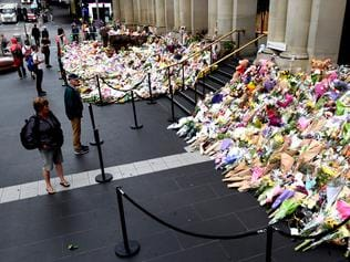 Flower tribute on the corner of Bourke street and Elizabeth street, Melbourne. People stop to pay tribute to the people killed and injured in the senseless act by 1 man driving his car though the Melbourne CBD with regard to nobody. Picture: Nicole Garmston