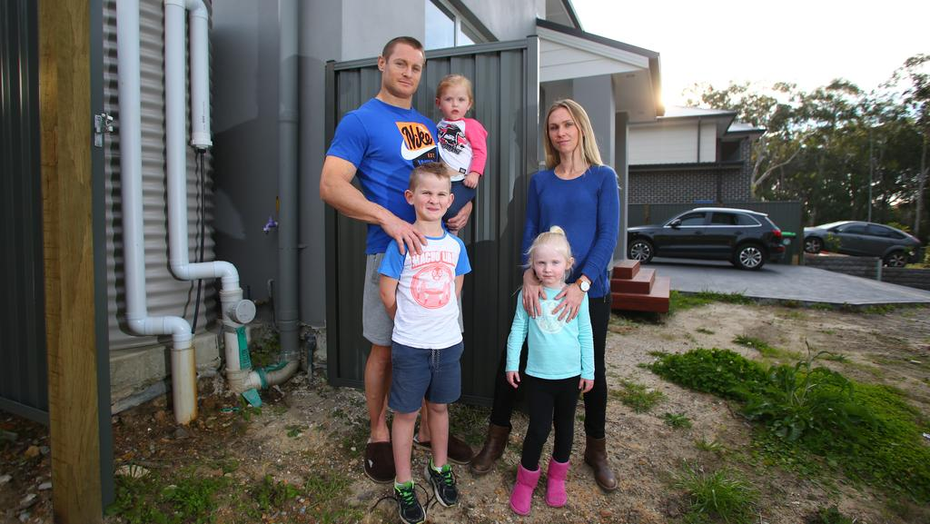 Lara and Hugh Perrett with children Levi, Grace and Abby outside their Kellyville home. Mrs Perrett said the collapse of Senator Bob Day's Home Australia building empire was 'justice'.