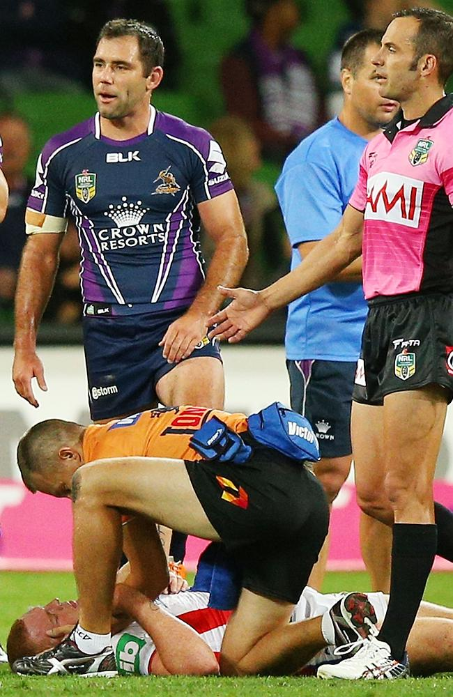 Alex McKinnon of the Knights lays on the ground after being tackled.