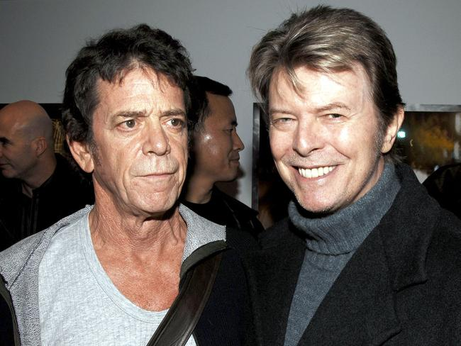 Lou Reed (L) and David Bowie (R) attending the opening of the Lou Reed NY photography exhibit at the Gallery at Hermes in New York City. Picture: AFP / GETTY IMAGES NORTH AMERICA / Andrew H. Walker