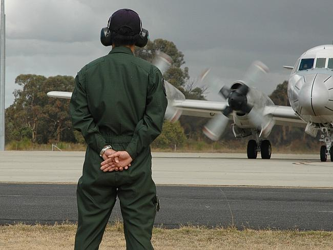 Departures ... ground crew watch a Japanese P-3C Orion take off from RAAF Base Pearce for