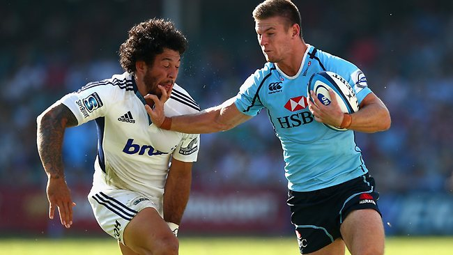 Waratahs winger Rob Horne fends off Blues rival Rene Ranger. Picture: Ryan Pierse