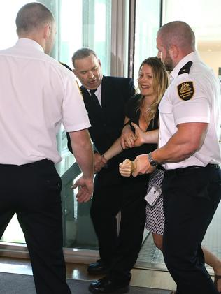 Protester Lily Matchett is removed by security at Parliament House. Picture Kym Smith