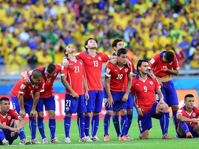 Chile's team line up during the penalty shoot out against Brazil.
