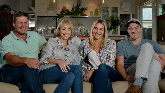 The Viney family- dad Jay, mum Leah, daughter Britt and son Harry relaxing in their modern extension.