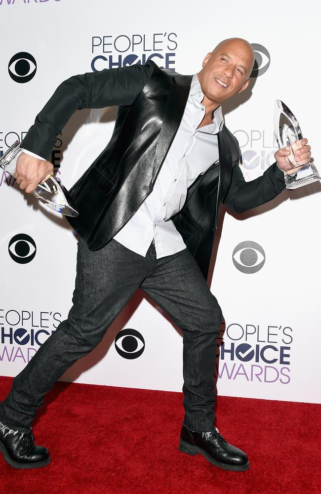"""Vin Diesel, winner of Favorite Movie and Favorite Action Movie for """"Furious 7"""", poses in the press room during the People's Choice Awards . Picture: Getty"""