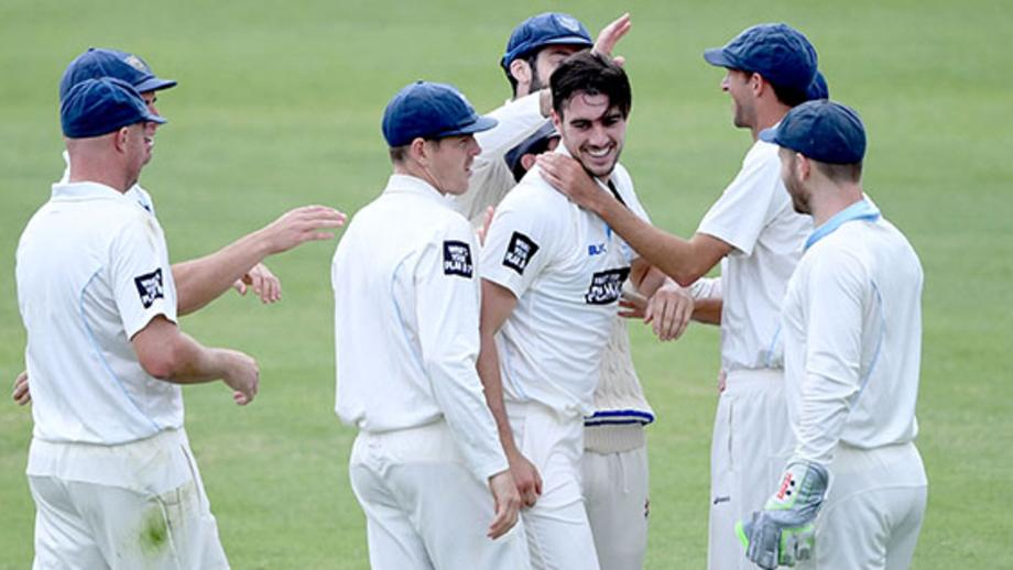 Pat Cummins is congratulated on claiming a wicket in his Sheffield Shield return. Picture: Delly Carr