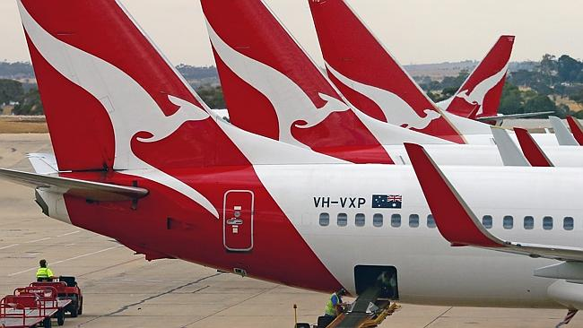 Dire ... Qantas aeroplanes wait at Melbourne Tullamarine Airport on February 25, as the company prepares to lay off thousands of workers.