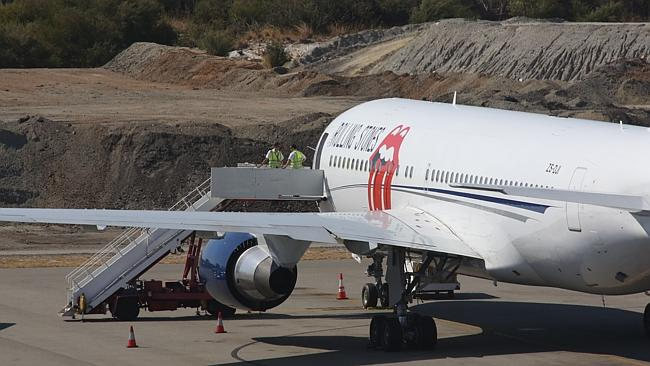 The Rolling Stones plane at Perth International Airport. Ground crew and staff on the stairs preparing the aircraft. Picture: Bohdan Warchomij