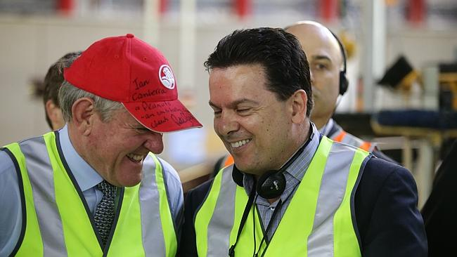Federal Industries Minister Ian Macfarlane and Senator Nick Xenophon at the Holden factory in Elizabeth, South Australia.
