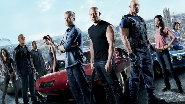 Paul Walker with Vin Diesel, Dwayne Johnson and the cast of Fast & Furious 6.