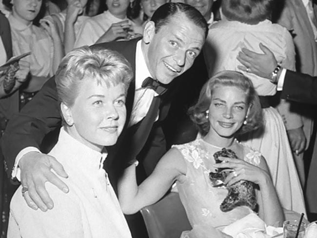 Doris Day, Frank Sinatra and Lauren Bacall are seen at the Sands Hotel on September 14, 1956 in Las Vegas, Nevada.