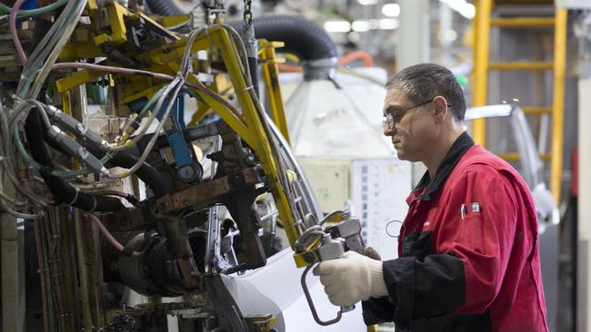 Plant closing down ... a worker in Toyota's Altona factory.