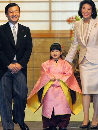 Japan's Princess Aiko, clad in a traditional ceremonial outfit, appears with her father Crown Prince Naruhito and her mother Crown Princess Masako after a centuries-old ceremony to wish her good health and to celebrate the passage from infancy to childhood at their residence, Togu Palace, in Tokyo, November 2006. Picture: AP /Koji Sasahara.