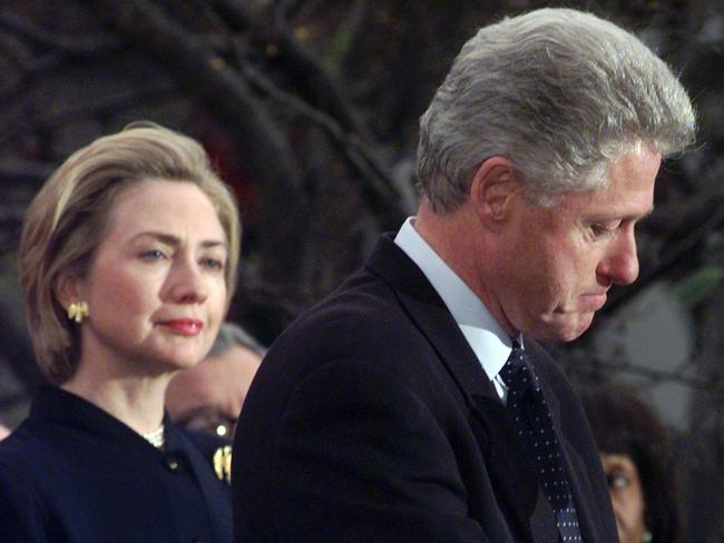 First time around ... Then First Lady Hillary Rodham Clinton watches President Bill Clinton pause as he thanks those Democratic members of the House of Representatives who voted against impeachment in 1998.