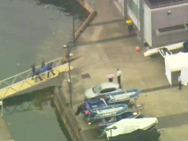 A body found in the water near Sydney's Opera House is taken back to Water Police Marine Area Command. Picture: Seven News